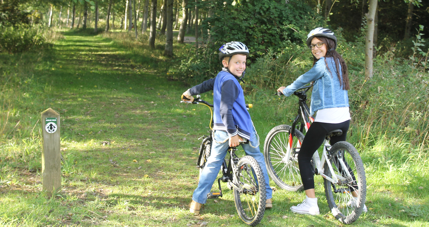 Two children on bikes, in the Forest of Marston Vale