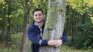 Man hugs a tree