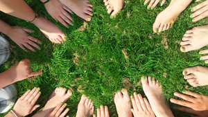 hands and feet on grass, in a circle